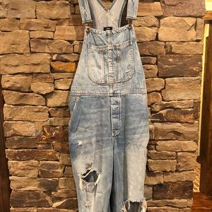 Distressed overalls.